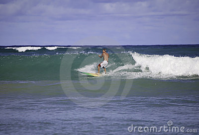 Sixty-four year old man surfing