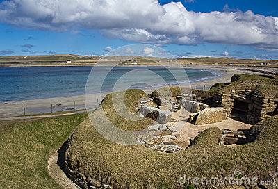 Skara Brae with Bay of Skaill in background