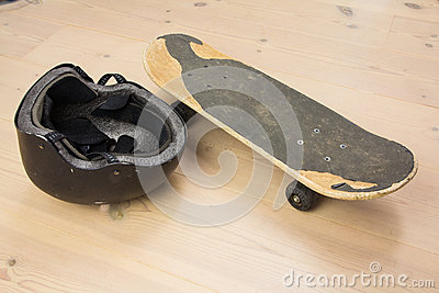Skateboard and protective helmet