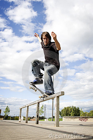Skateboarder doing a crooked grind