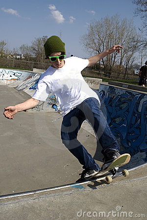 Free Skateboarder Doing Trick On Ramp Stock Photos - 5286173