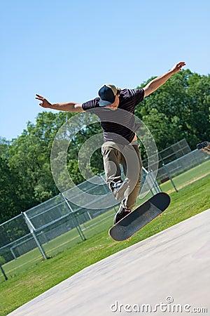 Skateboarder Doing Tricks On His