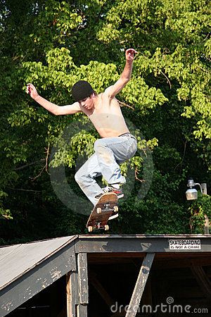 Skateboarder Going off Platform