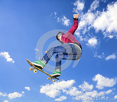 Skateboarder high in air