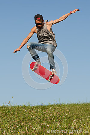 Free Skateboarder Leaping In The Air Royalty Free Stock Photos - 32450848
