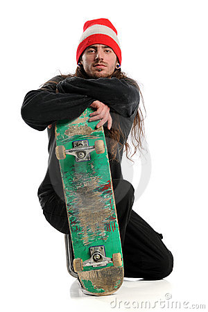 Skateboarder Posing With Board