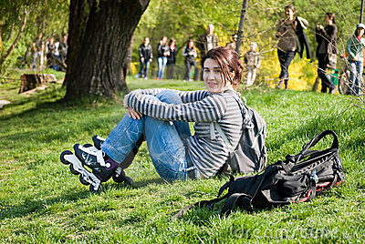 Skater girl resting in the park