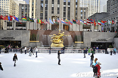 Skaters in Rockerfeller center in New York City Editorial Stock Image