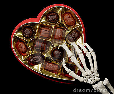 Skeleton hands selects a chocolate