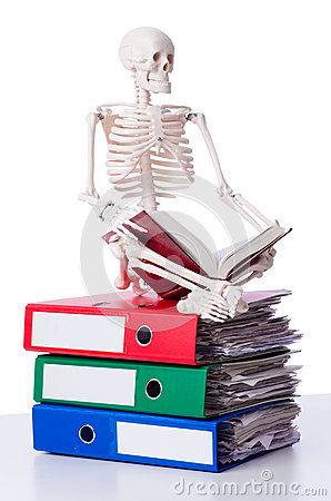 Skeleton with pile of files
