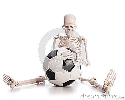 Skelett med fotboll