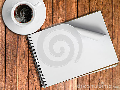 Sketch book and White cup of hot coffee