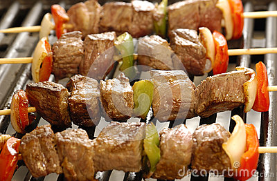 Skewers of meat on the grill