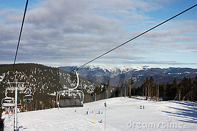 Ski chairlift. Winter. Mountain background