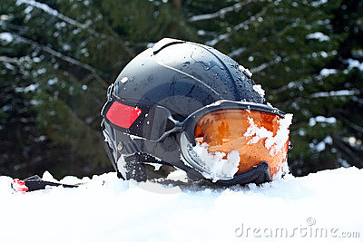 Ski helmet with goggles on the snow