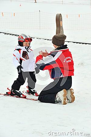 Ski instructor explain ski techniques to children Editorial Image