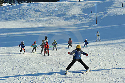 Ski instructor with small children on ski slope Editorial Photography