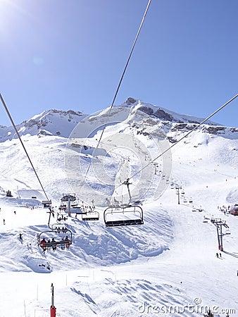 Ski lift carries skiers