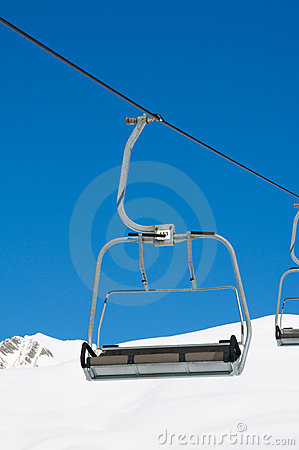 Ski lift chairs on bright day