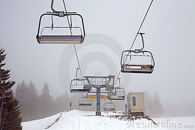 Ski lift in the fog