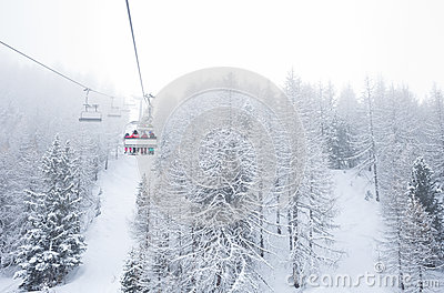 Ski lift with passengers in the gondola Stock Photo