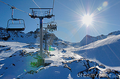 Ski lift and slope on the mountain