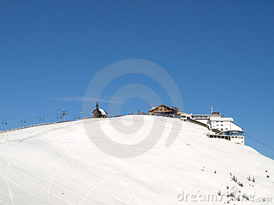 Ski lift on snowy mountain