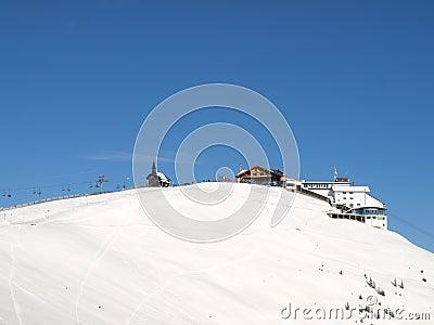 Ski lift on snowy mountain