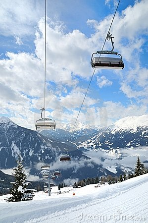 Ski lift in winter mountain