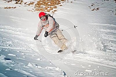 Ski rider in red helmet