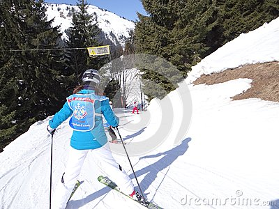 Ski school kids maneuver on an icy road Editorial Stock Photo