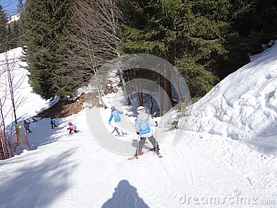 Ski school kids maneuver on an icy road Editorial Stock Image
