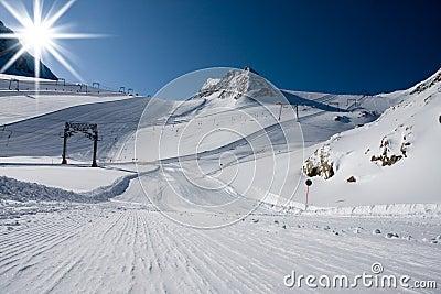 Ski slope in alps mountains