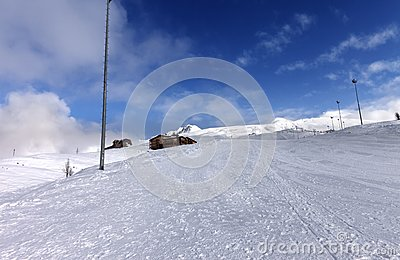 Ski slope and hotels in winter mountains