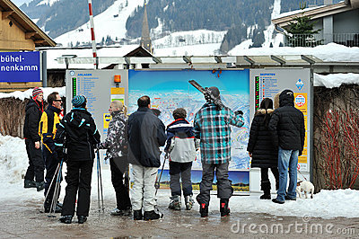 Ski slopes checking tablet for skiers Editorial Image