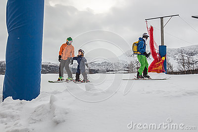 Ski teacher an pupil at the ski lift Editorial Stock Image