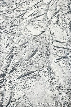 Ski tracks in snow.