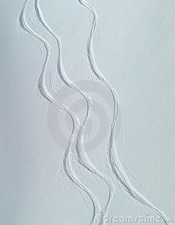 Ski tracks on snowy slope