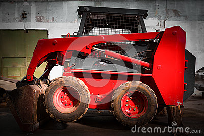 Skid loader in garage