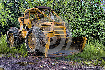 Skidder Rigged With A Snow Plow