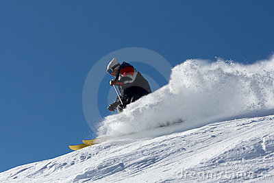 Skier in clouds of snow powder