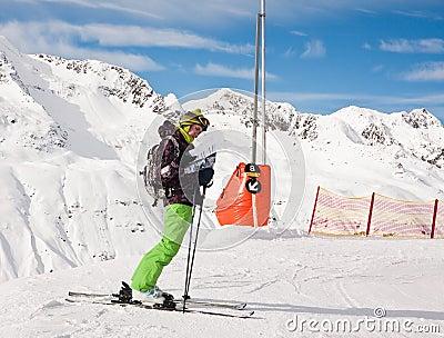 Skier considers skier slopes. Obergurgl. Austri