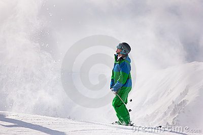 Skier dusting snow