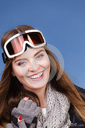 Skier girl wearing warm clothes ski googles portrait. Stock Photo