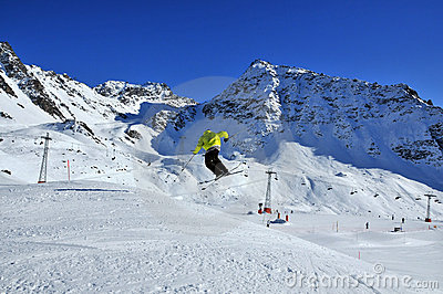 Skier jumping and turning at the same time