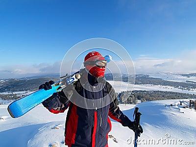 Skier looks on a mountain