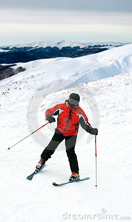 Skier man in snow mountains