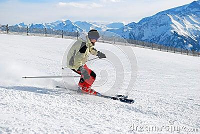 Skier moving down a ski track