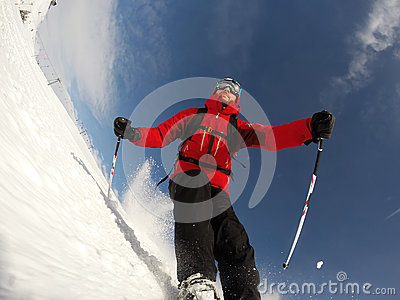 Skier performs a high speed turn on a ski slope.