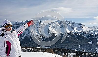 Skier pointing at the slopes of Ski resort